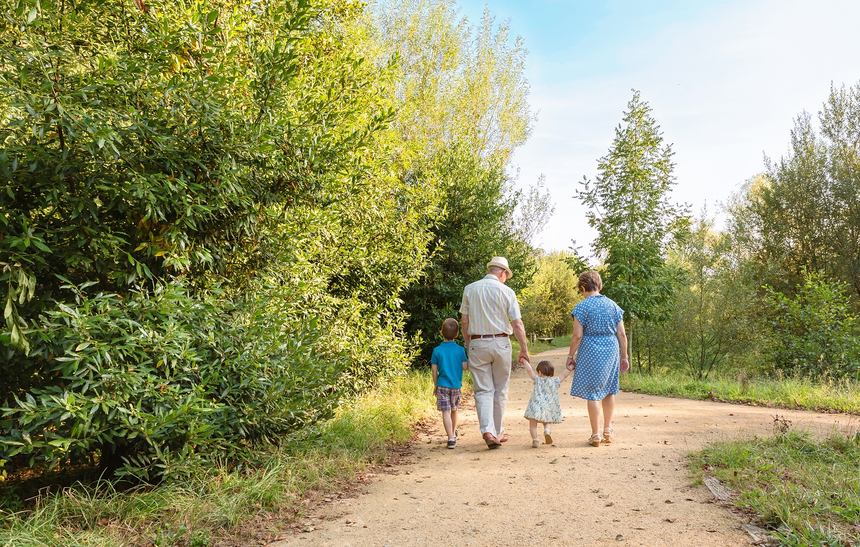 Grandparents walking with grandchildren